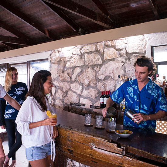 guests enjoy drinks at bar in smallhope